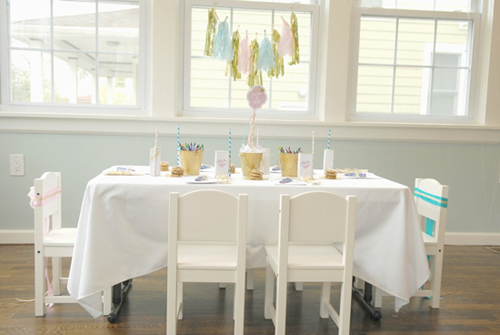 jack and jill party table with tissue garland